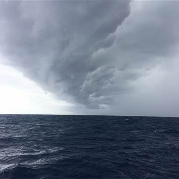 The outer bands of Hurricane Irma are seen from a Singing Dog Sailing catamaran at sea. Photo: Kelly Quinn