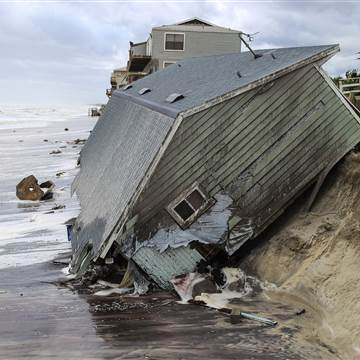 A house slides into the Atlantic Ocean in the aftermath of Hurricane Irma in Ponte Vedra  Photo: Beach, Florida on Monday. Gary Lloyd McCullough / The Florida Times-Union via AP